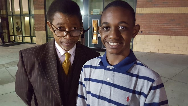 Dunbar-Ramer School principal James Owens (left) stands with sixth-grade student Amari Bell (right) who is credited with helping a first-grader suffering from an allergic reaction.
