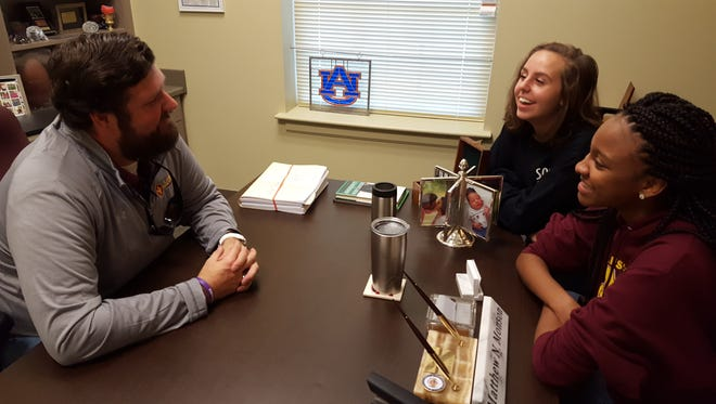 From left to right: LAMP Principal Matthew Monson, senior LAMP student Emily Magda and senior LAMP student Jailyn Holt discuss college plans in Monson's office.