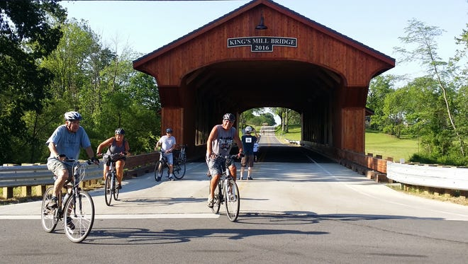 Cyclists enjoy the King's Mill Covered Bridge during the 2017 Hot Tamale Tour.