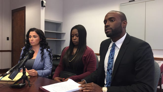From left to right: Attorney Jasmine Rand with client Ashanae Davis, 20, of Southfield, and attorney Maurice Davis at a news conference on Monday, June 4, 2018. The attorneys say Davis was detained, racially profiled, and forced to strip by Target store employees under the suscpicion that she stole a bikini from the retailer's Southfield location.
