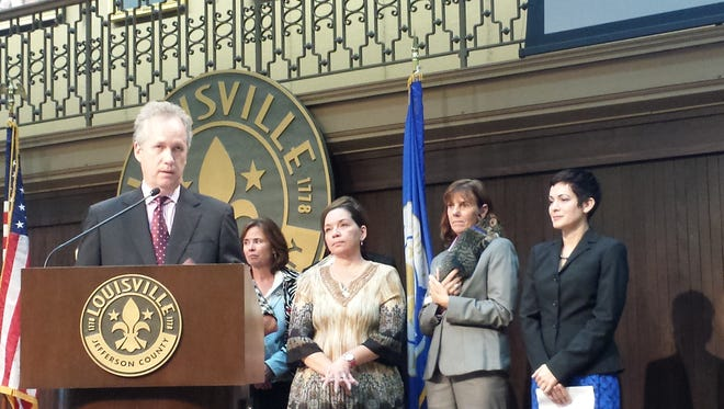 Mayor Greg Fischer announces the appointment of, from right, Jessica Jo Montgomery as director of Louisville Metro Animal Services, Stephanie Moore as assistant director for operations, and Daisey Blakeman as executive administrator at Metro Hall on Wednesday.