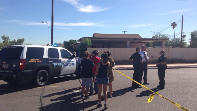 Two people were injured in an officer-involved shooting in Avondale on Oct. 23, 2014.