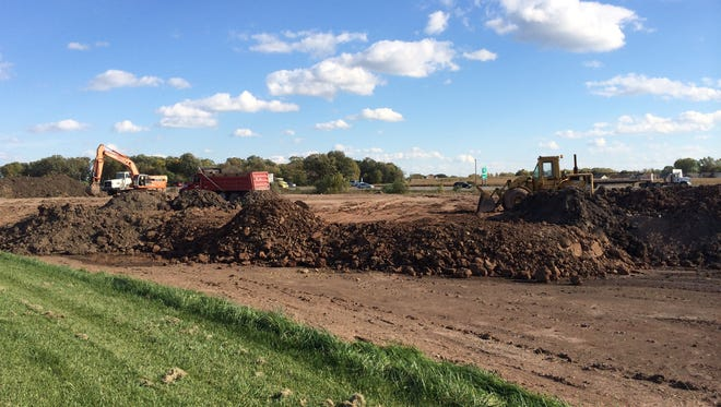 Earth-moving equipment at Commerce Crossing, a Kaukauna site along U.S. 41 at State 55.