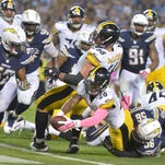 Oct 12, 2015; San Diego, CA, USA; Pittsburgh Steelers running back Le'Veon Bell (26) scores on a one-yard touchdown run with no time remaining against the San Diego Chargers at Qualcomm Stadium. The Steelers defeated the Chargers 24-20.
