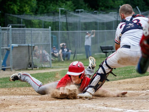 Hamilton junior Will Geels (13) beats the tag at home