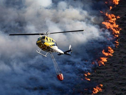 636016262454422641-RENBrd-06-14-2015-RGJ-1-A012--2015-06-13-IMG-Wildfire-Strategy-Gi-2-1-PIB2LBRO-L627601298-IMG-Wildfire-Strategy-Gi-2-1-PIB2LBRO.jpg