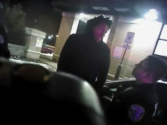 This Jan. 26, 2018 police body-camera footage released by Milwaukee Police Department shows Bucks guard Sterling Brown as he talks to arresting police officers before being shot by a stun gun in a Walgreens parking lot.