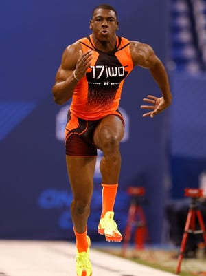 Michigan wide receiver Devin Funchess runs the 40-yard dash at the NFL scouting combine in Indianapolis on Feb. 21, 2015.