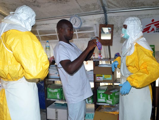 Ebola doctors sacrifice all to bring hope: Column