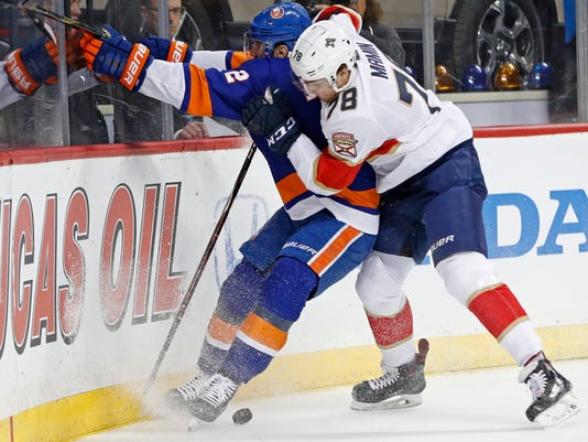 Florida Panthers center Maxim Mamin (78) of Russia pins New York Islanders defenseman Nick Leddy (2) against the boards during the first period of an NHL hockey game in New York, Monday, March 26, 2018. (AP Photo/Kathy Willens)