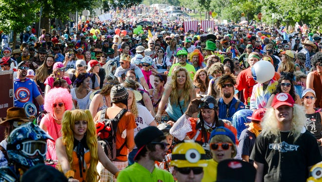An estimated 25,000 people flooded the streets of Fort Collins in 2014 for New Belgium's annual Tour de Fat in Fort Collins. This yearâ??s parade will hit town Sept. 5.