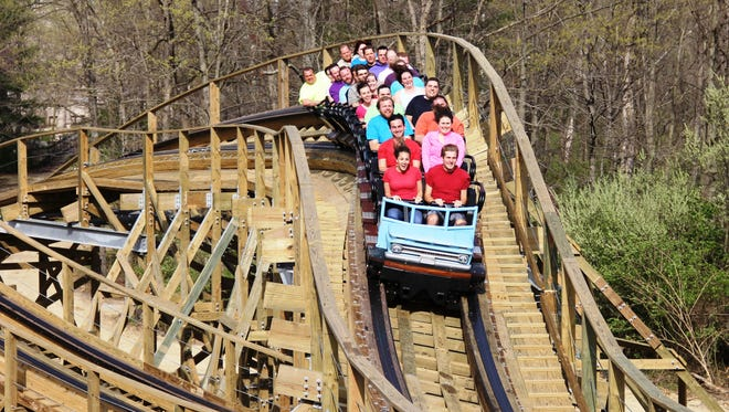 The new Mystic Timbers in 3,265 feet in length. It reaches 109 feet in height. It reaches speeds up to 53 mph and features a total of 16 airtime hills, and a mid-course tunnel.