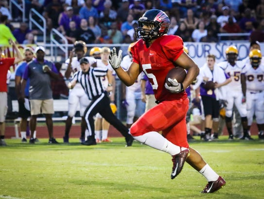 Stewarts Creek's Ke'shawn Walker gains yardage during