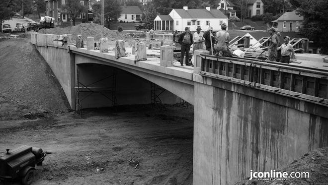 The new concrete North 18th Street span looking south over Ferry Street during the last stages of construction. Photo taken May 19, 1954.