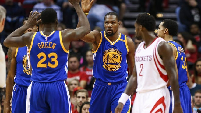 Golden State Warriors forward Kevin Durant (35) reacts after a play during the first half against the Houston Rockets at Toyota Center.