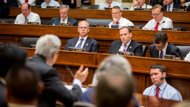 Members of the House Foreign Affairs Committee listen as Secretary of State John Kerry testifies in Washington, D.C., on July 28, 2015.