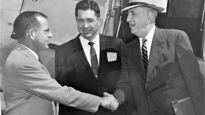 Sen. Richard Russell (right) is greeted during Augusta visit.