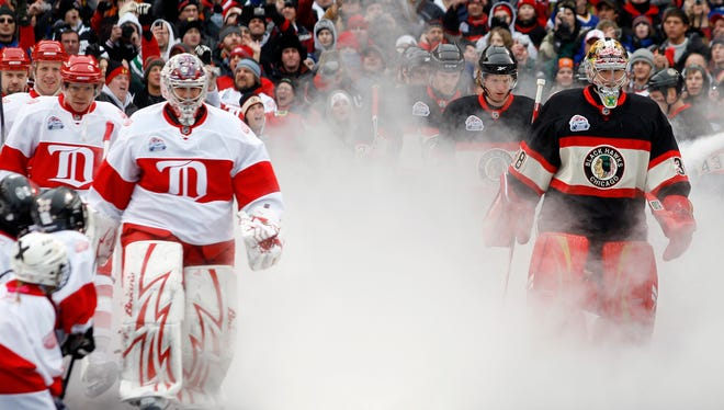 The Detroit Red Wings and Chicago Blackhawks take the ice at the 2009 Winter Classic at Wrigley Field.