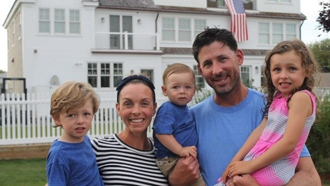 The Collins family relaxes while vacationing last week in Maine -- from left, Trevor, Kate, Seamus, Brian and Nora.