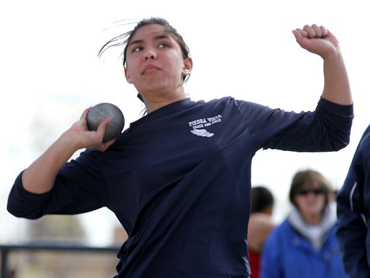 Piedra Vista's Angel Bridges competes in the shot put during the Aztec Top Gun Relays on Friday at Fred Cook Memorial Stadium in Aztec.