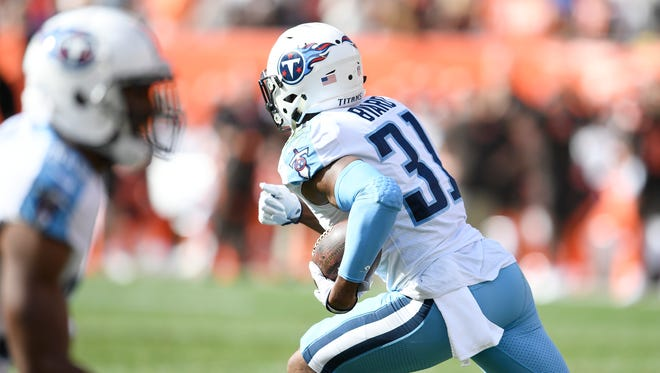 Titans safety Kevin Byard (31) races up the field with an interception during the second quarter Sunday.