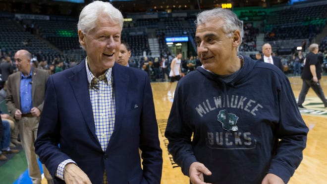 Former President Bill Clinton talks with Milwaukee Bucks co-owner Marc Lasry before Game 6 against the Boston Celtics on Thursday.