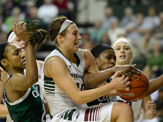 In middle, UW-Green Bay's Mehryn Kraker (10) battles for a rebound against Cleveland State's Alexis Eckles (24) and Imani Gordon (1) in the first half during Saturday's Horizon League game at the Kress Events Center in Green Bay. Evan Siegle/Press-Gazette Media