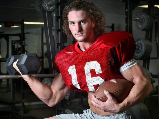 Stewarts Creek football player Chris Dye is a quarterback and a bodybuilder. Dye is in the football weight room at the school on Monday, Oct. 19, 2015.