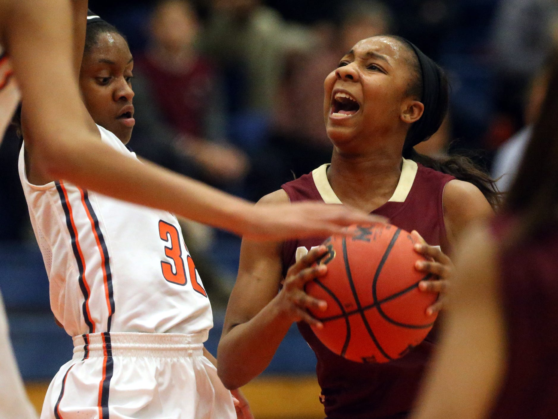HELEN COMER/DNJ Riverdale's Anastasia Hayes (right) goes up for a shot as Blackman's Crystal Dangerfield (left) defends.