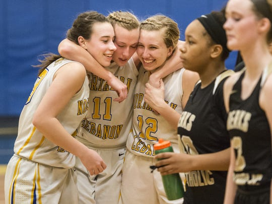 Northern Lebanon's Zoe Zerman (33),  Megan Brandt (11) and Amber Kintzer (12) and their teammates are set to meet arch rival Lancaster Catholic in the 4A district semifinals on Tuesday night.