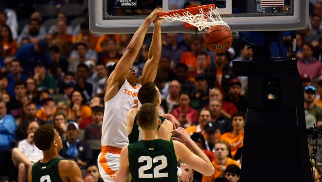 Tennessee forward Grant Williams (2) dunks the ball as Wright State guard Everett Winchester (2) and Wright State center Parker Ernsthausen (22) watch during the NCAA Tournament first round game between Tennessee and Wright State at American Airlines Center in Dallas, Texas, on Thursday, March 15, 2018.
