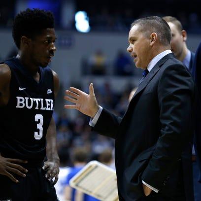 Butler Bulldogs head coach Chris Holtmann talks to