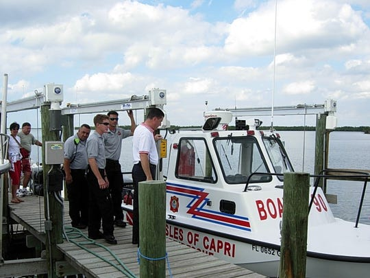 When the Isles of Capri Fire/Rescue Station 90 completed its dock and lift behind the station, a dedication ceremony was held so that residents of the district could see their Boat 90 hoisted on the lift and learn about the marine rescue services it provided.