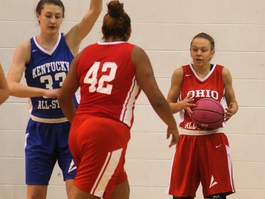 McAuley senior Hailee Heidemann inbounds the ball during