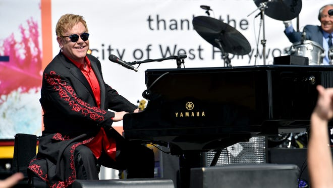 Elton John rocked the Sunset Strip Saturday with a free outdoor concert that featured a performance by Lady Gaga.  WEST HOLLYWOOD, CA - FEBRUARY 27:  Elton John performs live on the Sunset Strip, on February 27, 2016, as a thank you to the City of West Hollywood for their support of the Elton John AIDS Foundation.  The concert was streamed live on AOL.com and co-presented by AOL and BBVA.  (Photo by Dimitrios Kambouris/WireImage) ORG XMIT: 607212535 ORIG FILE ID: 512680900