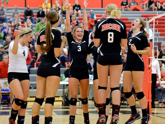 Rocori volleyball players celebrate their final point of their third game after winning 3-0 over the Otters of Fergus Falls on Thursday night in Cold Spring.