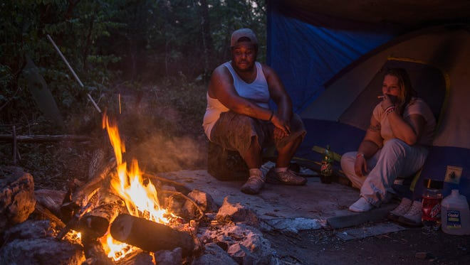 Homeless couple Alex and Ivy settle in at their campsite at Fort Negley on Sept. 5 in Nashville.