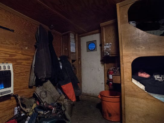 Roy Deal Jr. rests in a bunk aboard the Donna Lynn.