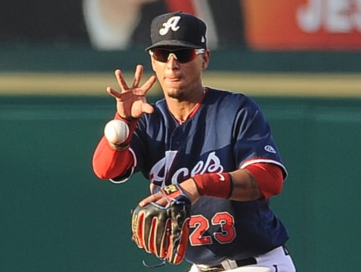 Second baseman Ronny Cedeno fields a ground ball as the Aces host the Sacramento River Cats on Saturday evening.