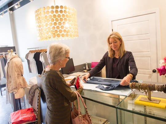 Valerie Chittick helps a customer at Domby's new location