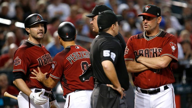 Diamondbacks manager Torey Lovullo (17) speaks to home plate umpire Jansen Visconti after Diamondbacks AJ Pollock (11) was tossed after arguing a third strike call against the Padres during the fifth inning at Chase Field in Phoenix, Ariz. on July 8, 2018.