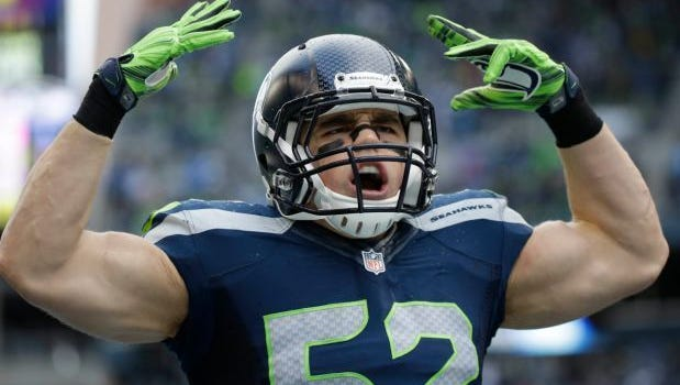 Seattle Seahawks middle linebacker Brock Coyle (52) pumps up the home crowd.