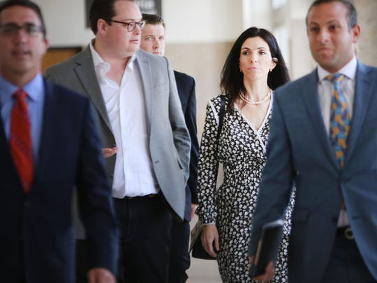 Maya Tsimhoni, center, and her husband divorced in