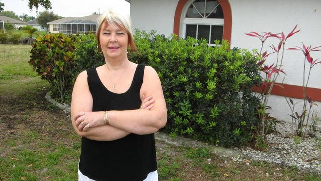 Nona Trogdon poses in front of her Cape Coral home. Nona and her husband Tim Trogdon opened Tim Trogdon Lawn Care in 1995, and they run the business from their home.