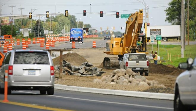 Road construction continues Tuesday on Stearns County Road 75 near 33rd Street South. An improved economy means a stabilized city budget, and the city of St. Cloud is trying to catch up on road work delayed by the Great Recession.