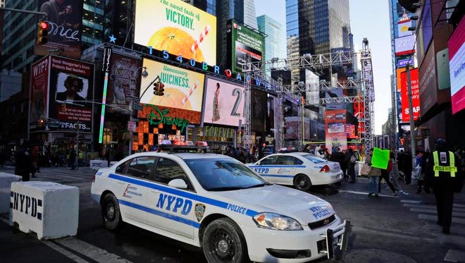 Police officers gather at Times Square during the NFL Super Bowl XLVIII Boulevard activities on Jan. 29, 2014, in New York City.