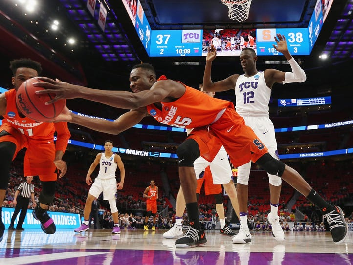 Bourama Sidibe of the Syracuse Orange attempts to rebound