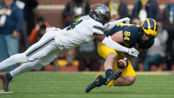 Michigan tight end Sean McKeon drops this pass while under pressure from Ohio State cornerback Jordan Fuller.