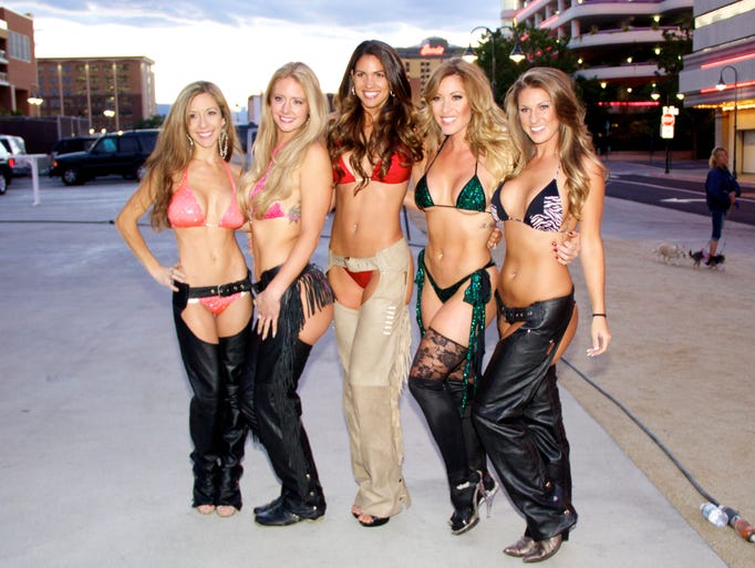 The International Bikini Team brings energy to downtown