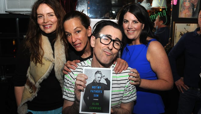 """Saffron Domini Burrows, Cynthia Rowley, Alan Cumming and Monica Lewinski attend the Alan Cumming Book Launch for """"Not My Father's Son"""" on October 6, 2014 in New York City."""